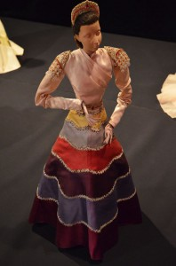 A long-sleeved evening gown by Italian designer Elsa Schiaparelli, part of the set Le Théâtre by Christian Bérard