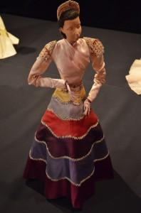 A long-sleeved evening gown by Italian designer Elsa Schiaparelli, part of the set Le Théâtre by Christian Bérard